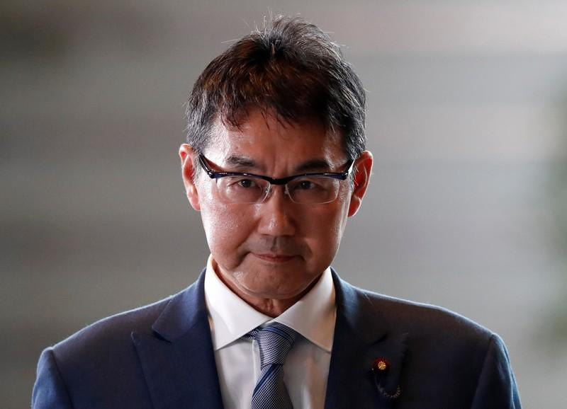 Japan's new Justice Minister Katsuyuki Kawai arrives to Prime Minister Shinzo Abe's official residence in Tokyo