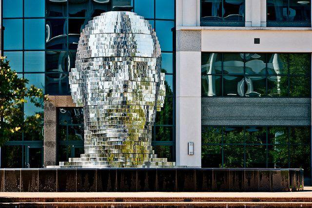 """<p>Head over to the Whitehall Technology Park in Charlotte for a <a href=""""http://www.thisiscolossal.com/2011/10/metalmorphosis-mirror-fountain-by-david-cerny/"""" rel=""""nofollow noopener"""" target=""""_blank"""" data-ylk=""""slk:notable work by Czech sculptor David Černý"""" class=""""link rapid-noclick-resp"""">notable work by Czech sculptor David Černý</a>: A 14-ton giant head made of rotating layers of stainless steel. <span class=""""redactor-invisible-space"""">(Flickr photo by <a href=""""https://flic.kr/p/MFfSXa"""" rel=""""nofollow noopener"""" target=""""_blank"""" data-ylk=""""slk:Nan Palmero"""" class=""""link rapid-noclick-resp"""">Nan Palmero</a><span class=""""redactor-invisible-space"""">)</span></span></p>"""
