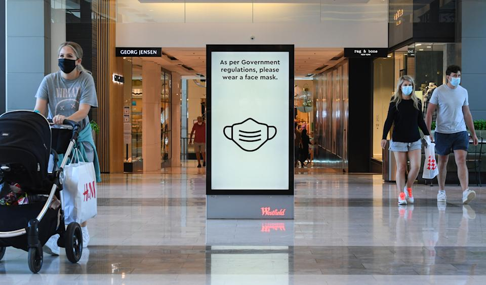 Digital signs encourage customers to wear face masks at Westfield Bondi Junction in January