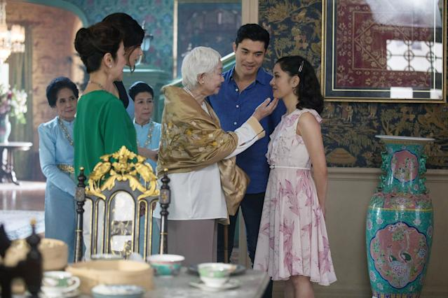 <em>Crazy Rich Asians</em> director Jon M. Chu recruited an ensemble that included, from left (in foreground): Michelle Yeoh, Gemma Chan, Lisa Lu, Henry Golding, and Constance Wu. (Photo: Warner Bros. Pictures/Courtesy Everett Collection)