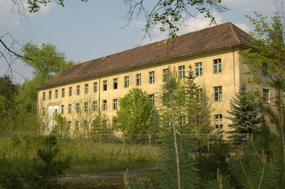 <p>The Wundsdorf Soviet Camp, the largest Soviet headquarters outside of Russia, stood shrouded in mystery in Hauptallee, Germany, 25 miles outside of Berlin.</p><p>For decades before the fall of the Berlin Wall, the site housed 75,000 men, women and children. When the wall crashed, the site was abandoned, leaving behind 100,000 rounds of ammunition and countless pieces of trash, furniture, and home supplies.</p>
