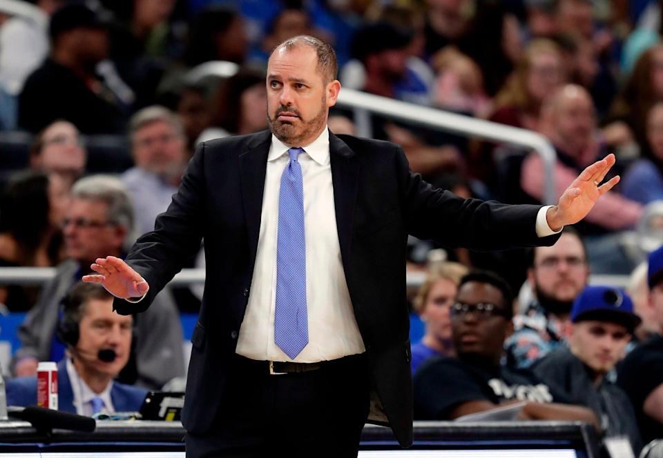Orlando Magic head coach Frank Vogel directs his players against the Washington Wizards during the first half of an NBA basketball game, Wednesday, April 11, 2018, in Orlando, Fla. (AP Photo/John Raoux)