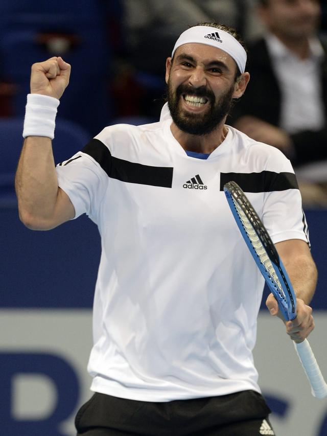 Cyprus' Marcos Baghdatis cheers during his first round match against Germany's Benjamin Becker during their first round match at the Swiss Indoors tennis tournament at the St. Jakobshalle in Basel, Switzerland, on Tuesday, Oct. 22, 2013. (AP Photo/Keystone,Georgios Kefalas)