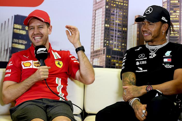 Ferrari's German driver Sebastian Vettel (L) and Mercedes' British driver Lewis Hamilton attend a press conference at the Albert Park circuit ahead of the Formula One Australian Grand Prix in Melbourne on March 12, 2020. (Photo by William WEST / AFP) / -- IMAGE RESTRICTED TO EDITORIAL USE - STRICTLY NO COMMERCIAL USE -- (Photo by WILLIAM WEST/AFP via Getty Images)