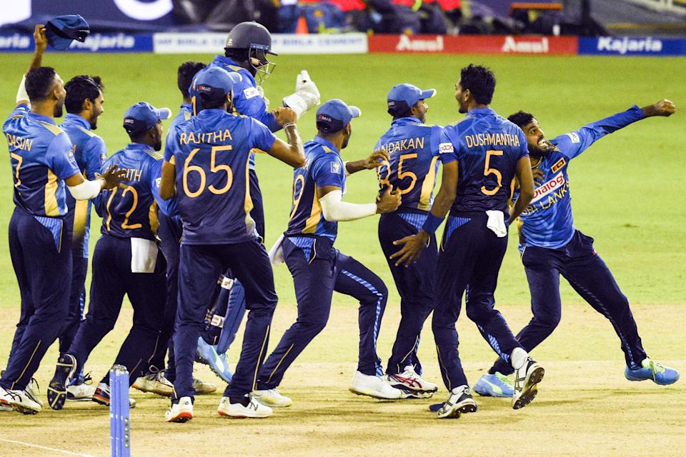 Sri Lanka's Wanindu Hasaranga (R) celebrates with his teammates after the dismissal of India's captain Shikhar Dhawan (not pictured) during the second one-day international (ODI) cricket match between Sri Lanka and India at the R.Premadasa Stadium in Colombo on July 20, 2021. (Photo by Ishara S. KODIKARA / AFP) (Photo by ISHARA S. KODIKARA/AFP via Getty Images)