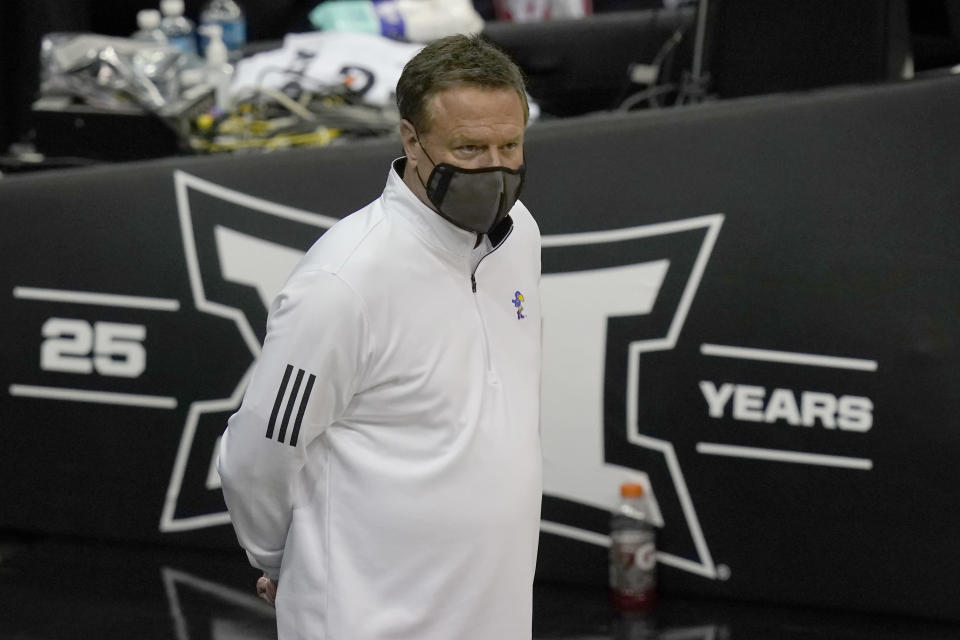 Kansas head coach Bill Self watches player introductions before an NCAA college basketball game against Oklahoma in the quarterfinal round of the Big 12 men's tournament in Kansas City, Mo., Thursday, March 11, 2021. (AP Photo/Orlin Wagner)