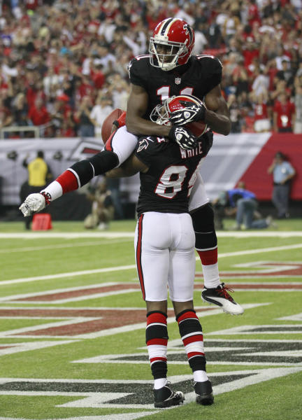 Atlanta Falcons wide receiver Roddy White (84) celebrates with Julio Jones (11) after catching a touchdown pass during the first half of an NFL football game against the Carolina Panthers Sunday, Sept. 30, 2012, in Atlanta. (AP Photo/John Bazemore)
