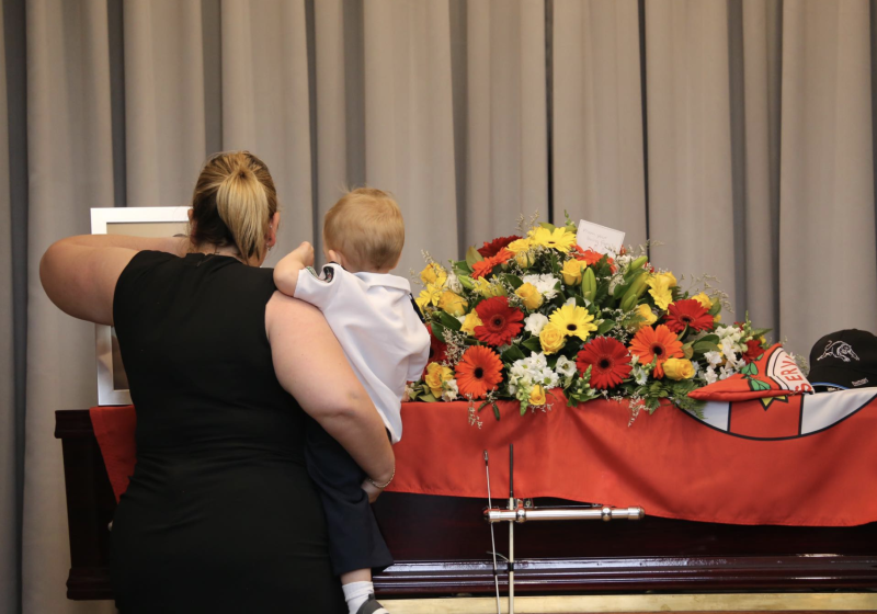 Mr Keaton's fiancee Jess Hayes and Harvey are seen standing next to the 32-year-old's coffin. Source: RFS