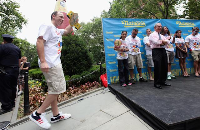Five-time hot dog eating world champion Joey Chesnut walks onstage at the Nathan's Famous Fourth of July International Hot Dog Eating Contest weigh-in ceremony on July 3, 2012 in New York City. The annual hot odg eating event is expected to draw 30,000 fans on July 4, in Coney Island section of Brooklyn. (Photo by Mario Tama/Getty Images)