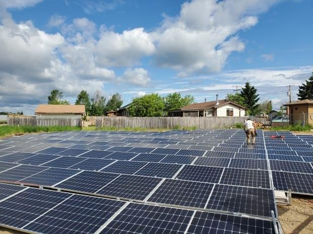 The community of Ile-a-la-Crosse has now branched into solar power and had their senior class at the high school put the panels together to learn about the infrastructure.  (Submitted by David Isaac  - image credit)
