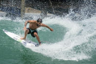 Surfer Italo Ferreira from Brazil works out on a Surf Ranch wave during practice rounds for the upcoming Olympics Tuesday, June 15, 2021, in Lemoore, Calif. This year, Ferreira and fellow Brazilian Gabriel Medina are expected to rule the men's competition at surfing's long-awaited debut as an Olympic sport in the Tokyo 2020 Games. While the surfing community has long pledged that the ocean is for everyone, a look at the professional ranks show a sport that remains expensive and inaccessible. A series of recent industry efforts to help groom the next generation outside of the usual hot spots of Hawaii, California and Australia look to be a tacit acknowledgement of the existing disparities among its talent bench. (AP Photo/Noah Berger)