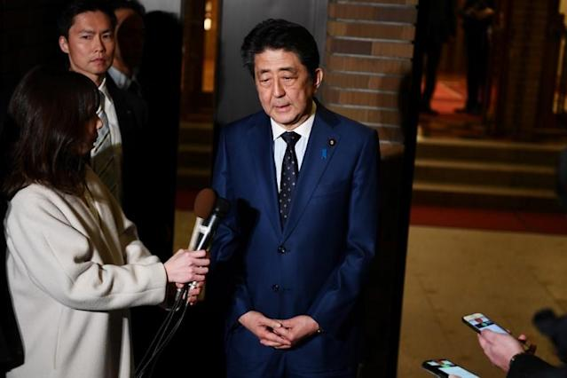 Japan's Prime Minister Shinzo Abe talks to the journalists in front of the prime minister's residence in Tokyo