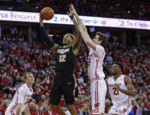Purdue's Vincent Edwards (12) shoots against Wisconsin's Nate Reuvers (35) during the first half of an NCAA college basketball game Thursday, Feb. 15, 2018, in Madison, Wis. (AP Photo/Andy Manis)