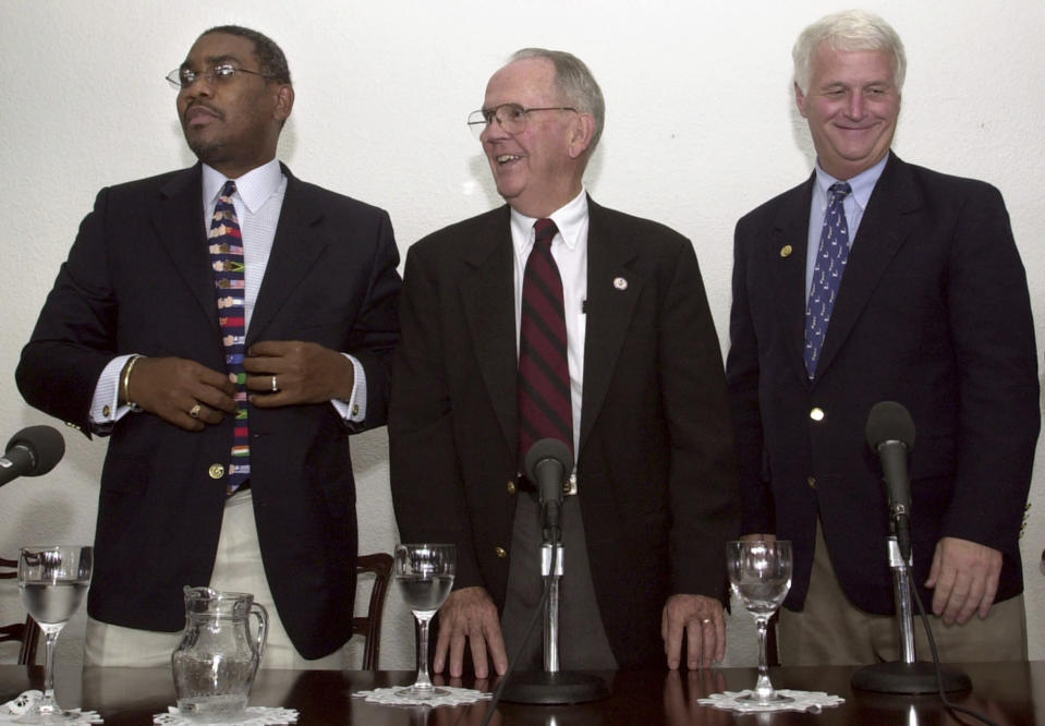"""FILE - In this Oct. 23, 2003 file photo, U.S. Congressmen Gregory W. Meeks (D-NY), left, Cass Ballenger (D-NC), center, and William D. Delahunt (D-MA), smile after giving a news conference in the home of US ambassador to Venezuela in Caracas, Venezuela. Meeks, the new chairman of the House Foreign Affairs Committee under the Joe Biden administration in 2021, is likely to be a key interlocutor for the incoming administration's efforts to de-escalate tensions with Venezuela. """"Maduro doesn't trust his own shadow. But he might trust Gregory Meeks,"""" said Delahunt. (AP Photo/Leslie Mazoch, File)"""