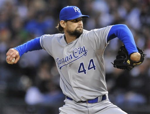 Kansas City Royals starter Luke Hochevar delivers a pitch against the Chicago White Sox in the first inning during a baseball game in Chicago, Saturday, May, 12, 2012. (AP Photo/Paul Beaty)