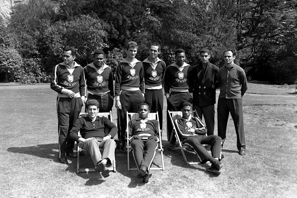 Brazil players relax in the grounds of the Hotel Sanderstead in Surrey: (back row, l-r) Zito, Coutinho, Eduardo, Gilmar, Pele, Rildo, Pepe; (front row, l-r) Roberto Dias, Lima, Mengalvio  (Photo by S&G/PA Images via Getty Images)