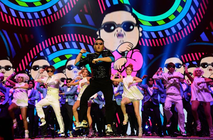 """""""Gangnam Style,"""" a music video featuring the infectious, meme-ready dance moves of a little-known South Korean rapper named Psy, became the most-watched video in YouTube history in 2012, racking up more than 815 million views and knocking Justin Bieber off the most-viewed throne. (Kevin Mazur/WireImage)"""