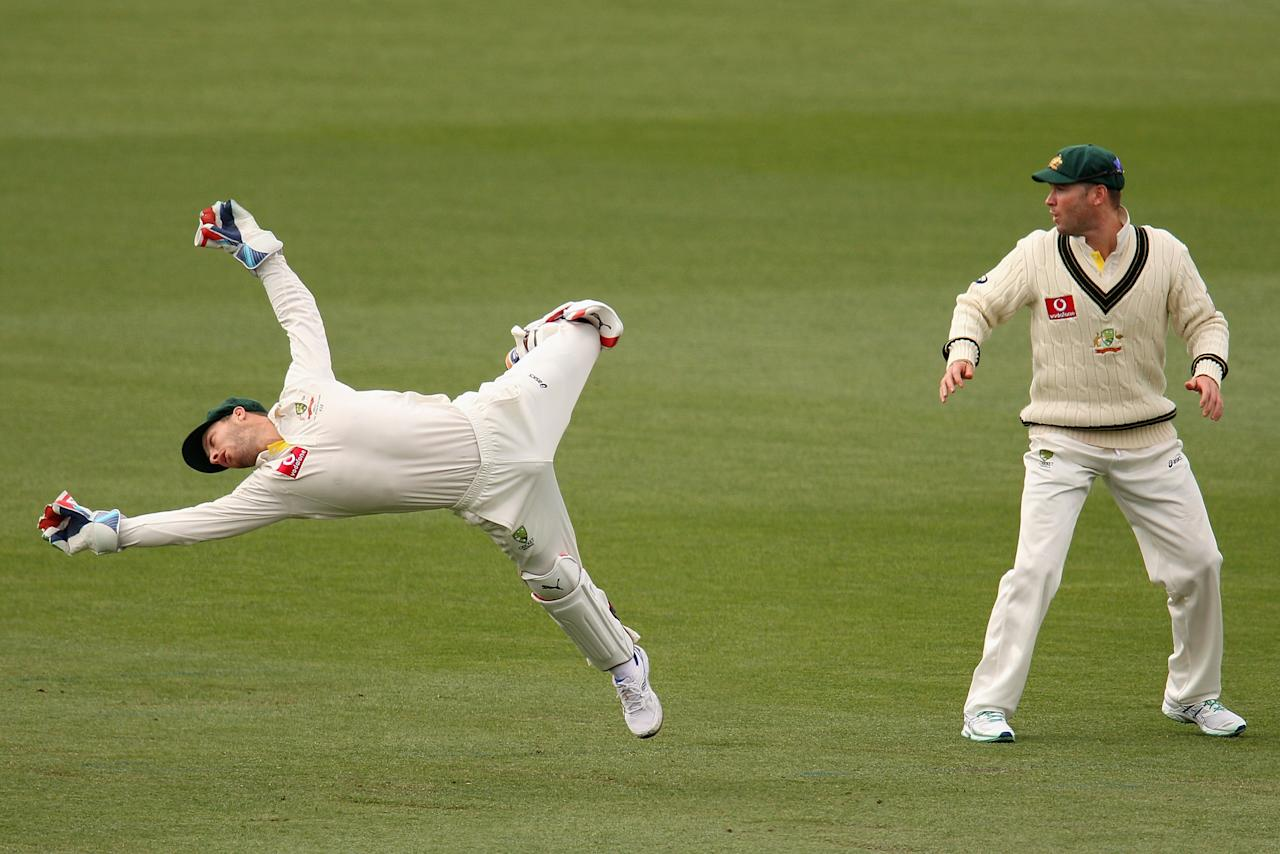 HOBART, AUSTRALIA - DECEMBER 17:  Matthew Wade of Australia dives for the ball during day four of the First Test match between Australia and Sri Lanka at Blundstone Arena on December 17, 2012 in Hobart, Australia.  (Photo by Robert Prezioso/Getty Images)