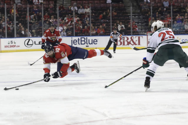 Florida Panthers right wing Brett Connolly (10) is found by Minnesota Wild defenseman Jonas Brodin (25) during the first period of an NHL hockey game, Tuesday, Dec. 3, 2019, in Sunrise, Fla. (AP Photo/Lynne Sladky)