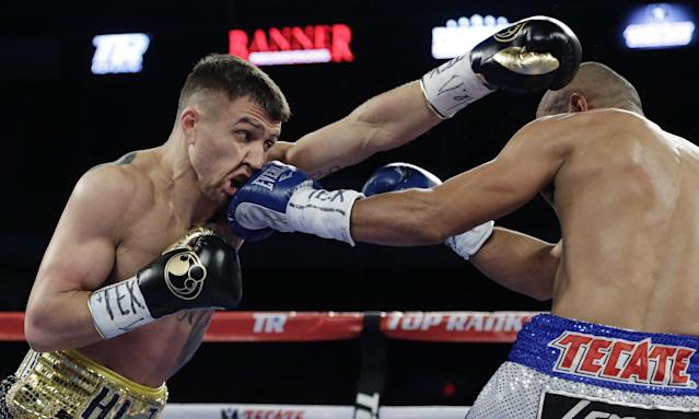 Vasyl Lomachenko had no answers for veteran Orlando Salido in 2014. (AP)