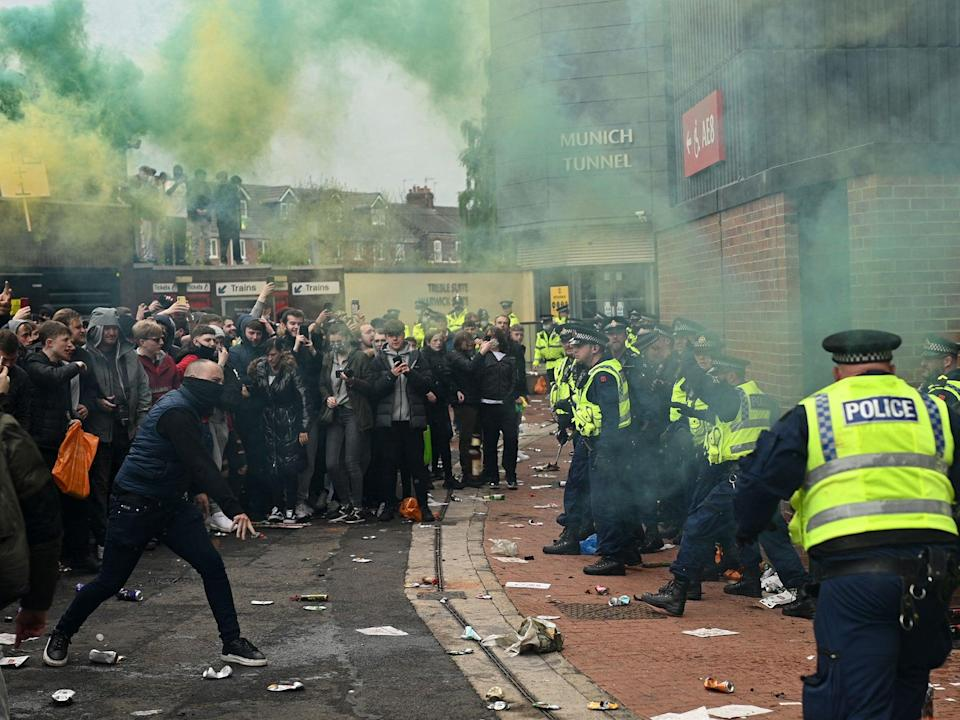 Supporters clash with police during a protest against Manchester United's owners (AFP/Getty)