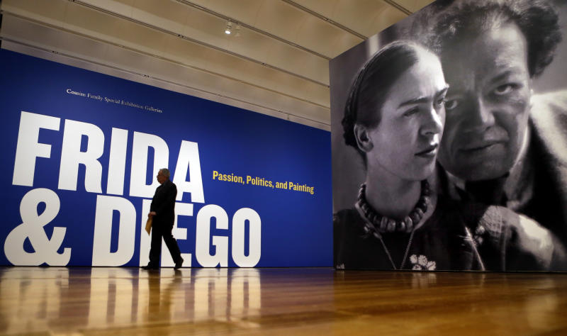 "This Feb. 8, 2013 photo shows a giant image of artists Frida Kahlo and Diego Rivera at the entrance to the exhibition ""Frida & Diego: Passion, Politics, and Painting,"" at the High Museum in Atlanta. The exhibit features more than 140 works, making it the largest exhibition of the couple's art ever displayed together. Atlanta's High will be the only U.S. venue for the exhibition, which opens Feb. 14 and runs through May 12. (AP Photo/David Goldman)"