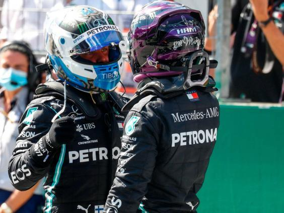 Valtteri Bottas is congratulated by Lewis Hamilton after taking pole position (AFP via Getty)