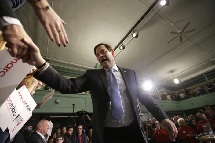<p>Republican presidential candidate Sen. Marco Rubio, R-Fla., shakes hands with members of the audience at the conclusion of a campaign event, Tuesday, Feb. 2, 2016, in Exeter. <i>(Photo: Steven Senne/AP)</i></p>