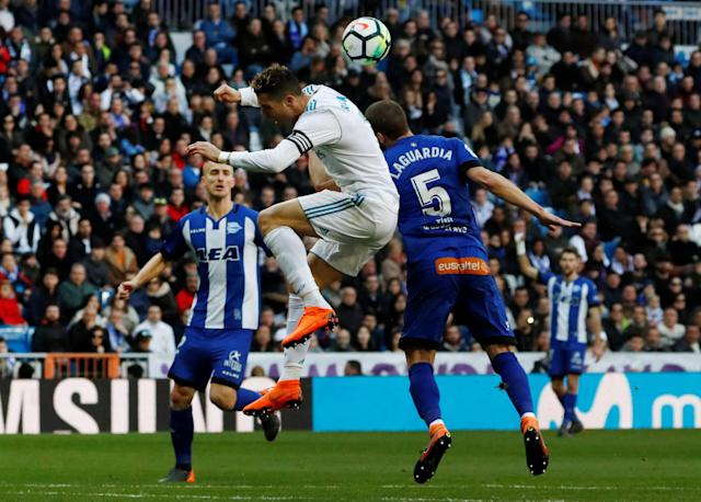 Soccer Football - La Liga Santander - Real Madrid vs Deportivo Alaves - Santiago Bernabeu, Madrid, Spain - February 24, 2018 Real Madrid's Cristiano Ronaldo in action with Alaves' Victor Laguardia REUTERS/Juan Medina