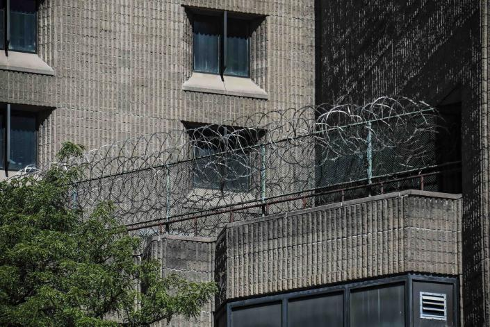 FILE - This Aug. 10, 2019, shows razor wire fencing at the Metropolitan Correctional Center in New York. Once hailed as a prototype for a new kind of federal jail and the most secure in the country, the Metropolitan Correctional Center has become a blighted wreck, with infrastructure so crumbling it's impossible to safely house inmates there. And so the Justice Department said last month it would close the jail by the end of October to undertake much-needed repairs. But it may never reopen. (AP Photo/Bebeto Matthews, File)