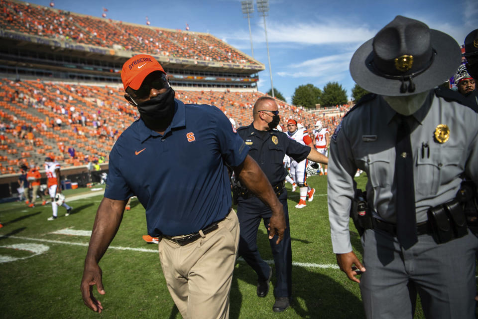 Syracuse head coach Dino Babers walks off the field after an NCAA college football game against Clemson in Clemson, S.C., on Saturday, Oct. 24, 2020. (Ken Ruinard/Pool Photo via AP)