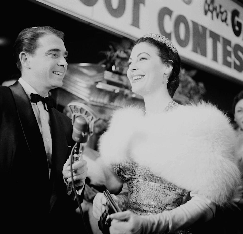 <p>Here, Gardner arrives to the premiere of <em>The Barefoot Contessa</em> in Los Angeles looking regal and wearing a fur stole, evening gloves, and a diamond tiara. <br></p>