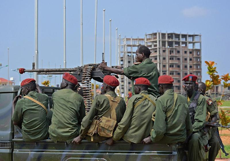 South Sudanese soldiers secure a road near Juba's airport on August 26, 2014 (AFP Photo/Samir Bol)