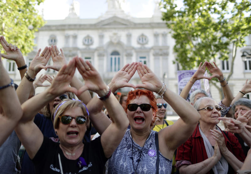"Women protest after Spain's top court found five men known as the ""La Manada,"" or ""The Animal Pack."" guilty of rape outside the Supreme Court in Madrid, Spain, Friday, June 21, 2019. Spain's Supreme Court on Friday overruled two lower courts and sentenced five men to 15 years in prison each for raping an 18-year-old woman. (AP Photo/Manu Fernandez)"