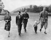 Queen Elizabeth II walking along with her daughter Princess Ann, Prince Philip, King Feisal II of Iraq (second left) take a stroll through Balmoral's grounds in 1952.(AFP via Getty Images)