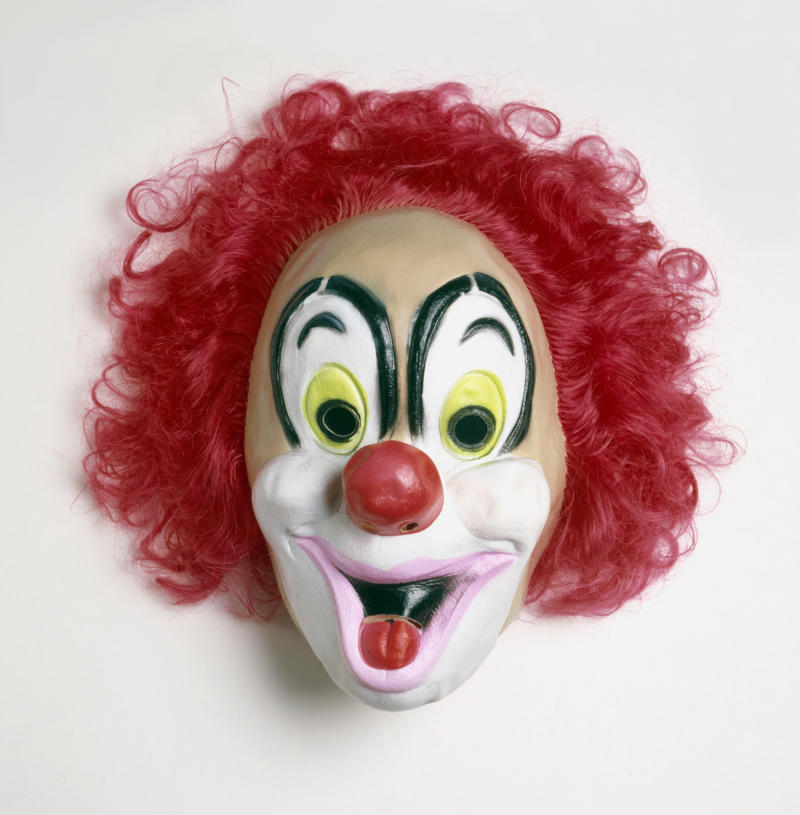 The father allegedly told police that he was only trying to discipline his daughter when he put on the clown mask, a similar one seen here, to scare her. (Dorling Kindersley via Getty Images)