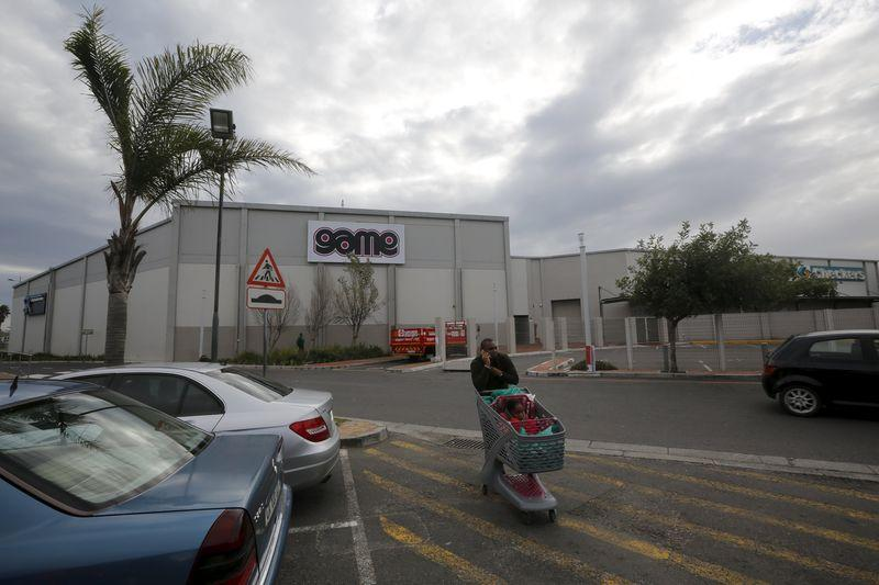 A man walks past an outlet for Massmart-owned Game Stores in Cape Town
