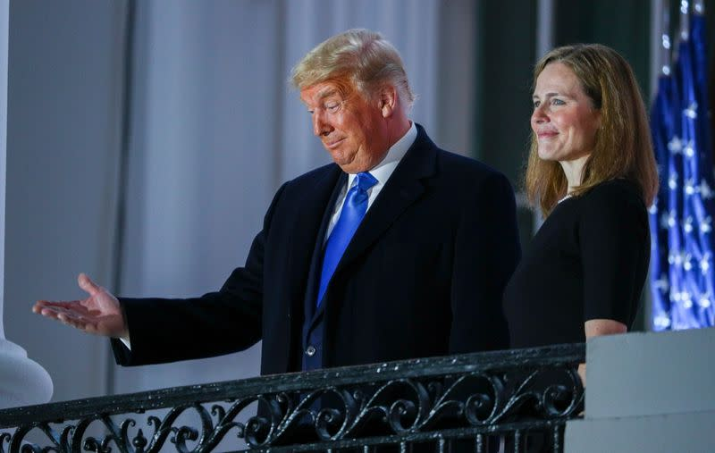 Judge Amy Coney is sworn in to serve as an associate justice of the U.S. Supreme Court at the White House in Washington