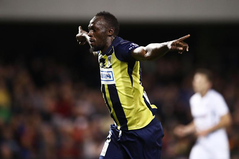 Bolt celebrates his first goal in football: Getty Images