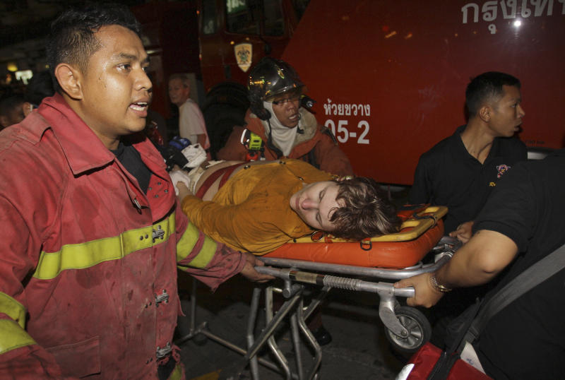 Thai firefighters move victim of a hotel fire to hospital in Bangkok on Thursday March 8, 2012. A fire has burned part of a high-rise hotel in Bangkok's main tourist district.(AP Photo/Sakchai Lalit)