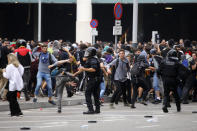 Riot policemen clash with protestors outside El Prat airport in Barcelona, Spain, Monday, Oct. 14, 2019. Riot police have charged at protesters outside Barcelona's airport after the Supreme Court sentenced 12 prominent Catalan separatists to lengthy prison terms for their roles in a 2017 push for the wealthy Spanish region's independence. (AP Photo/Emilio Morenatti)