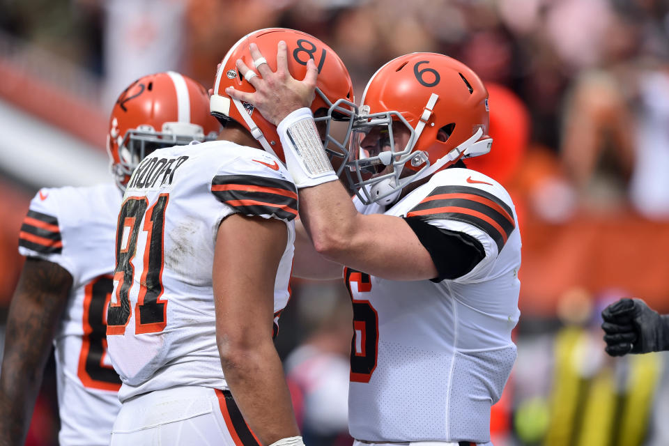 Cleveland Browns quarterback Baker Mayfield (6) celebrates with tight end Austin Hooper (81) after Hooper caught a 13-yard touchdown pass during the first half of an NFL football game against the Chicago Bears, Sunday, Sept. 26, 2021, in Cleveland. (AP Photo/David Richard)