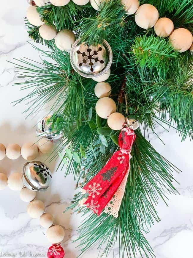 """<p>A basic garland gets dressed up with jingle bells, wooden beads and bits of lacy ribbon to make it extra-special.<br></p><p><strong>See more at <a href=""""https://averageinspired.com/2019/10/how-to-make-a-jingle-bell-wood-bead-garland-for-christmas.html"""" rel=""""nofollow noopener"""" target=""""_blank"""" data-ylk=""""slk:Average But Inspired"""" class=""""link rapid-noclick-resp"""">Average But Inspired</a>.</strong></p><p><a class=""""link rapid-noclick-resp"""" href=""""https://www.amazon.com/Maydahui-Snowflakes-Elliptical-Christmas-Halloween/dp/B083HCZJQY/ref=sr_1_22?dchild=1&keywords=jingle+bells+for+crafts+large&qid=1633170425&sr=8-22&tag=syn-yahoo-20&ascsubtag=%5Bartid%7C2164.g.37723896%5Bsrc%7Cyahoo-us"""" rel=""""nofollow noopener"""" target=""""_blank"""" data-ylk=""""slk:SHOP JINGLE BELLS"""">SHOP JINGLE BELLS</a></p>"""