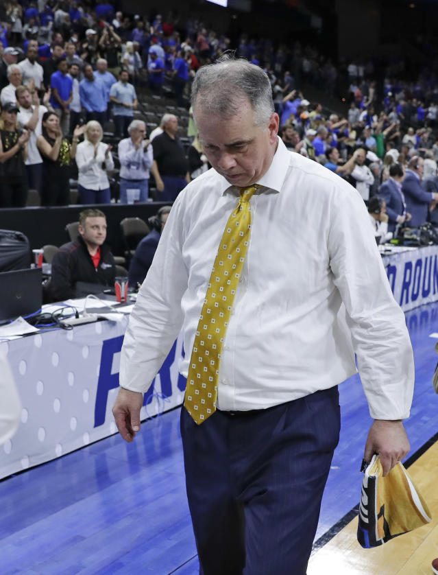 Wofford head coach Mike Young walks off the court after losing to Kentucky in a second-round game in the NCAA mens college basketball tournament in Jacksonville, Fla., Saturday, March 23, 2019. (AP Photo/John Raoux)