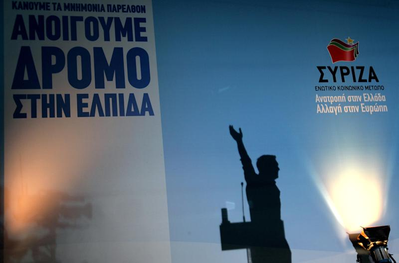 "The shadow of Alexis Tsipras, head of Greece's radical left-wing Syriza party is seen as he waves to his supporters during a rally at Omonia square in Athens, Thursday, June 14, 2012. The background reads ""We open the way for hope,"" and ""Syriza, reversal in Greece, change in Europe."" Greece faces crucial national elections on Sunday, that could ultimately determine whether the debt-saddled, recession bound country remains in the eurozone. (AP Photo/Petros Karadjias)"