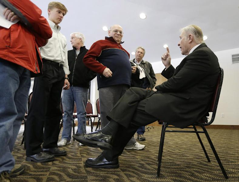 In this photo taken March 25, 2013, Rep. Steve Chabot, R-Ohio, takes time after his town hall meeting to answer questions one-on-one with constituents in Montgomery, Ohio. Here in the Cincinnati suburbs, where people tend to be polite, one finds seeds of the bitter partisanship that gnaws at Washington, 500 miles away. If any Republican House members might be open to compromise with President Barack Obama and Democratic lawmakers, Chabot would seem near the top. Yet he toes an unyielding conservative line on virtually every big issue. (AP Photo/Al Behrman)