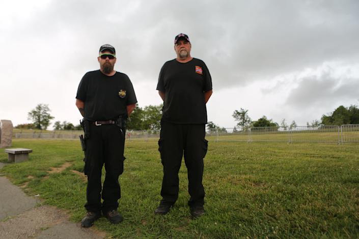Billy Snuffer (right),the Imperial Wizard for the Rebel Brigade of the Knights of the Ku Klux Klan, stands on the Gettysburg battlefield with another Klan member.