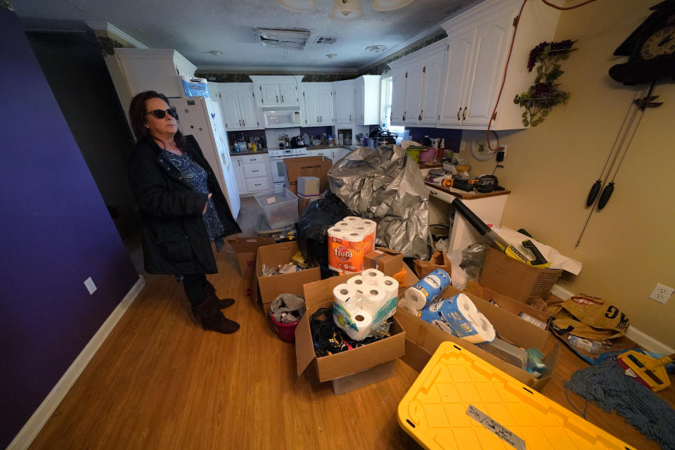 Provisions are piled on the floor of Dewana Young's heavily damaged home, in the aftermath of both Hurricane Laura and Hurricane Delta, in Grand Lake, La., Friday, Dec. 4, 2020. (AP Photo/Gerald Herbert)