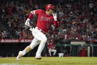 Los Angeles Angels designated hitter Shohei Ohtani rounds first on his way to a triple during the third inning of a baseball game against the Seattle Mariners Saturday, Sept. 25, 2021, in Anaheim, Calif. (AP Photo/Mark J. Terrill)