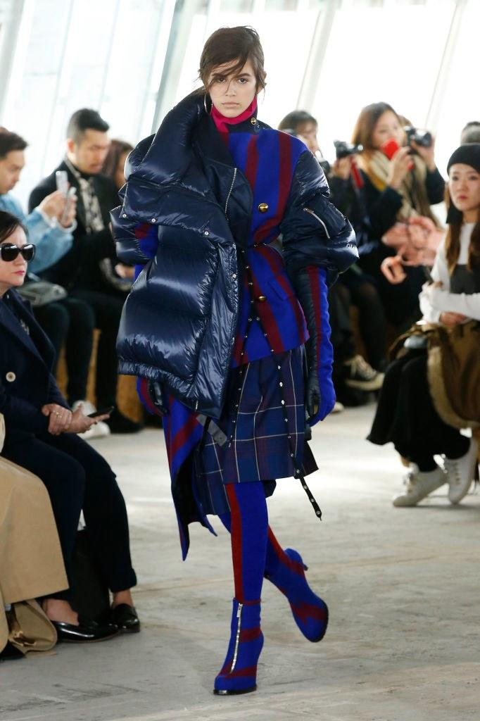 Kaia Gerber walks the runway during the Sacai Fall 2018 show as part of Paris Fashion Week on March 5, 2018 in Paris, France. Photo courtesy of Getty Images.